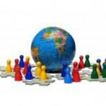 Game figures, representing people, stand around a toy globe