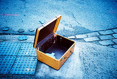 Empty yellow suitcase on a blue background.