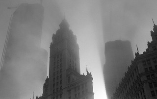 A foggy blacklit cityscape in black and white