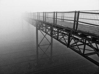 Bridge leading into the fog