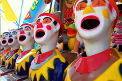 Laughing clowns game at a carnival