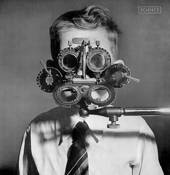 1940's boy with eye testing equipment