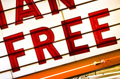 Backlit theatre billboard showing the word 'free'.