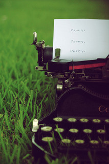 Typewriter on green lawn