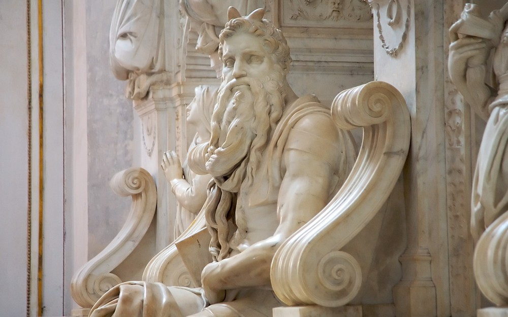 A white marble sculpture of a bearded devil