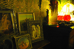 An art nouveau sideboard with picture frames