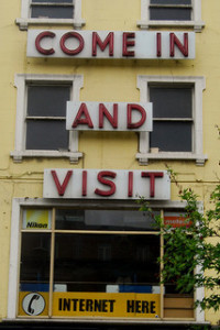 Old shop with 'Come in and visit' signage on front