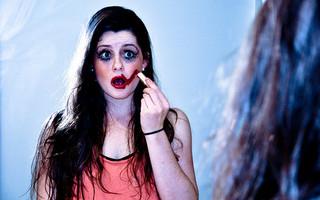 Woman making a slip when applying makeup.