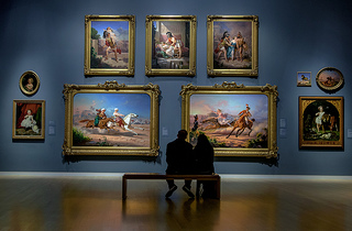 A couple enjoying masterworks at a gallery