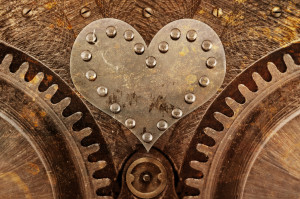 Grungy background with a metallic heart and rivets
