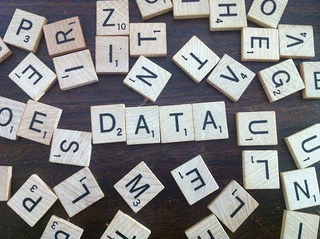 Scrabble letters spelling DATA amongst a jumble.