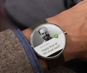 The Moto360 smartwatch on a wrist.