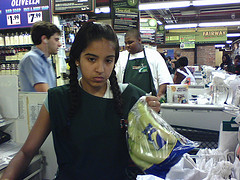 Checkout clerk looking unimpressed.