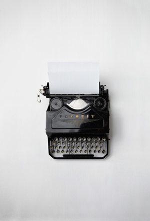 Typewriter with blank page.