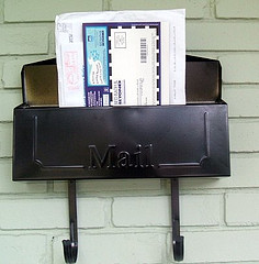 Mail poking out of a mailbox