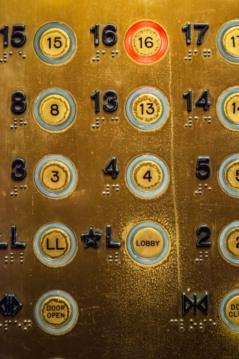 A well worn elevator panel