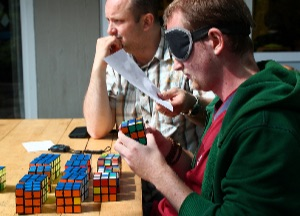 Former world record holder Kai Jiptner, trying to solve 16 Rubik's cubes blindfolded (this would have been world record at the time). Unfortunately, he did not quite make it.
