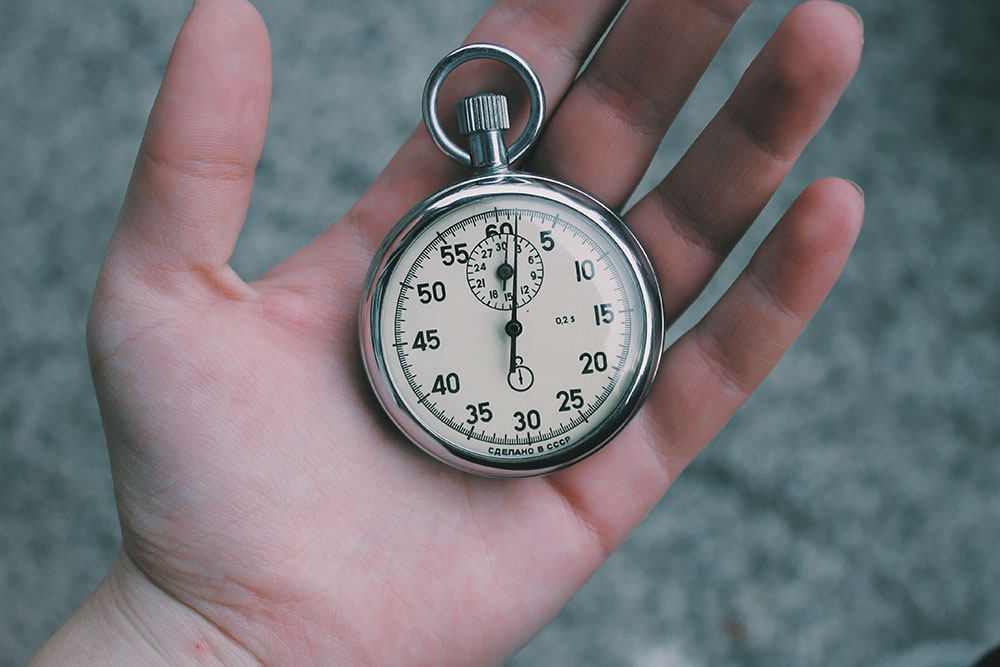 A person holding a pocketwatch