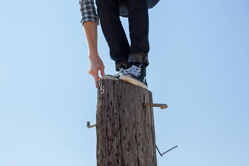 A person balancing on a pole