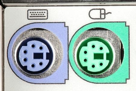 PS/2 ports for keyboards and mice, illustrating how they use an interchangeable format making it too easy to accidentally insert one into the other.